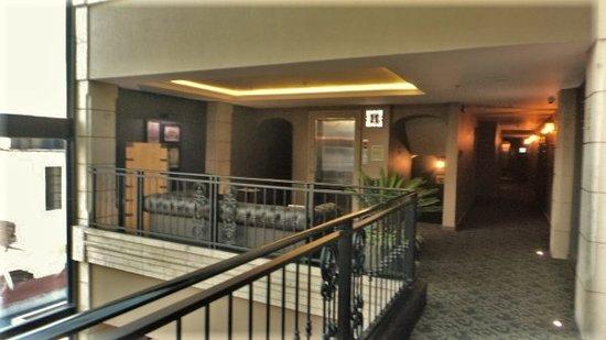 Hallway leading to elevators and seating area