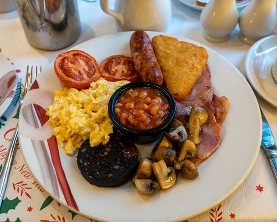 The very tasty full English breakfast - eggs, bacon, sausage, tomato, mushrooms, baked beans, hash brown and  Bury black pudding all well presented.
