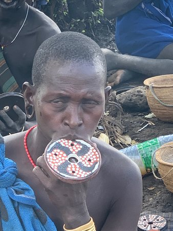 A Mursi woman showing off her lip plate.