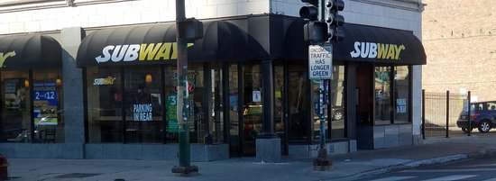 front of and entrance to Subway at the corner of the intersection of Chicago Ave., Milwaukee Ave. and Ogden Ave.