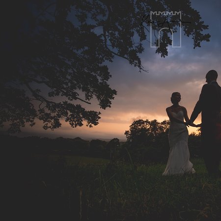 Folly Farm Silhouette of weddings couple in nearby countryside
