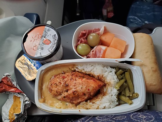 Delta Air Lines: Delicious Chicken breast, prosciutto and melon salad, and salted caramel ice cream for dessert.