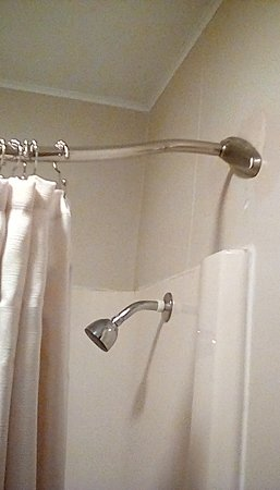 Loogootee, IN: Shower curtain rod is hung weird, so the curtain doesnt stay fully closed