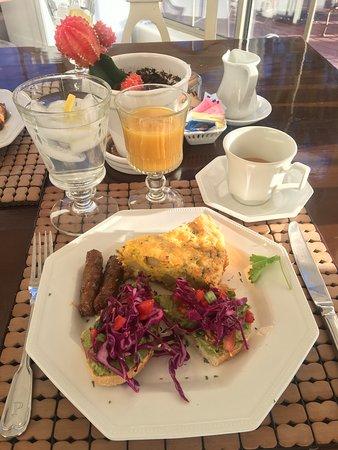 main breakfast meal - potato frittata, avocado toast, sausage