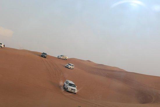 Morning Desert Safari on Red Dunes with Sand Boarding + Optional Quad Biking صورة فوتوغرافية