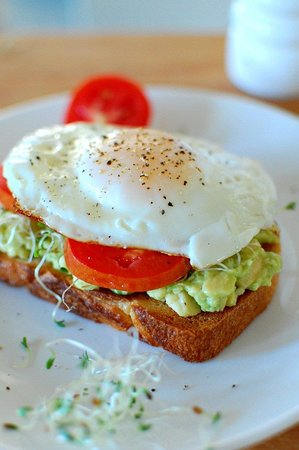 Wheat 🌾 bread 🍞 with egg 🥚 poached add some avocado 🥑 an make your day 😘