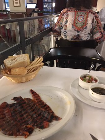 The well-stocked bread basket as well as the grilled peppers (morrones asados).