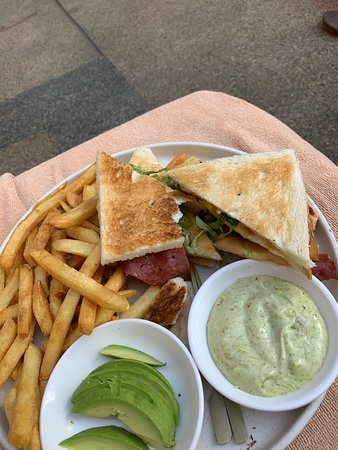 Triple deck sandwich from the swim up bar over cooked chips.