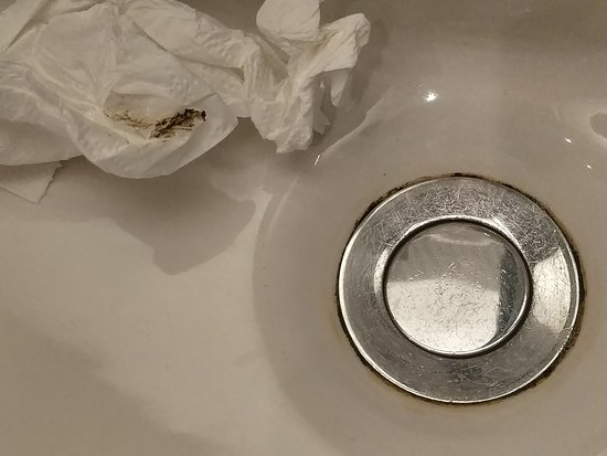 Room 306 - basin in bathroom hadn't been cleaned properly for a while.