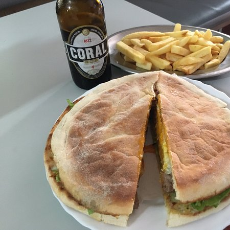Raposeira Do Logarinho, Португалия: Steak sandwich called prego made in a traditional bread called bolo do caco with parsley and garlic butter spread.