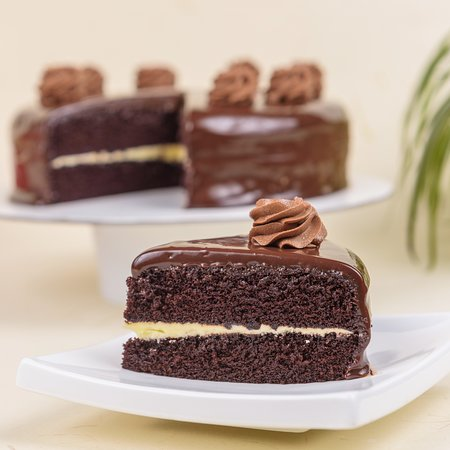 Chocolate Treat ~ Soft, moist chocolate cake sandwiched with butter icing and topped with chocolate ganache