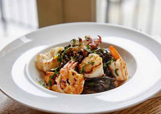 Squid ink linguini, with shrimp, scallops, calamari, tomato sauce, chilies, orange zest
