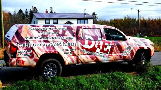 A professional photo of our truck.  Important aspects of the decal design:  Our address is 502 Willow Street, We do the cookin... so you don't have to! Free Samples.