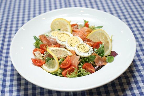 Our salad. Smoked salmon, hard boiled egg, tomato, yogurt dressing..