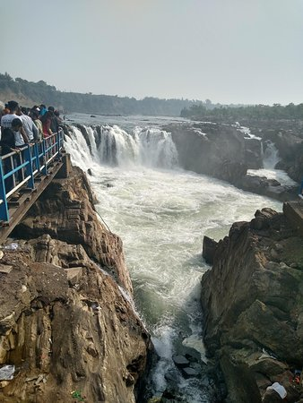 Another view of the Dhuadhar Falls with the water flowing through the gorge