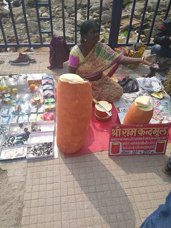 A street vendor selling 'Ram Kandha Mool' a tuber said to have been consumed by Lord Ram during his exile
