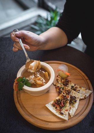 Samudari Charu  Spicy mix seafood and fresh coriander flavored soup