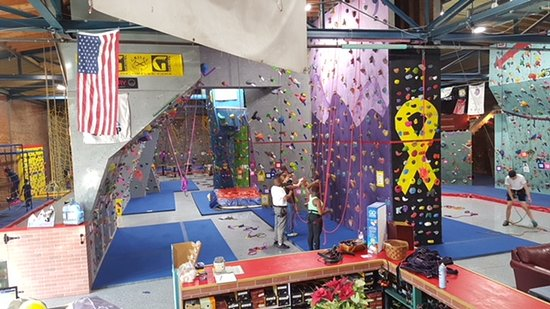 Plenty of space for everyone, 55+ top ropes, 4 auto belays, 300' traverse (one way), slacklines and obstacles.  Belay classes available upon request at any time.