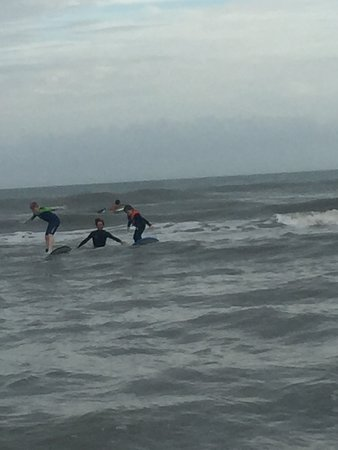 My 9 and 6 year old sons are feeling confident and enjoying their first surfing experience with Brian.