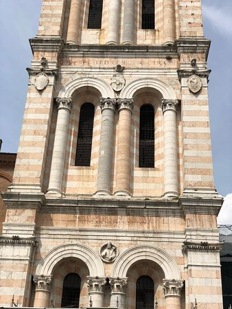 The cathedral might be closed but go around the corner to see the pretty blush pink and white striped campanile tower