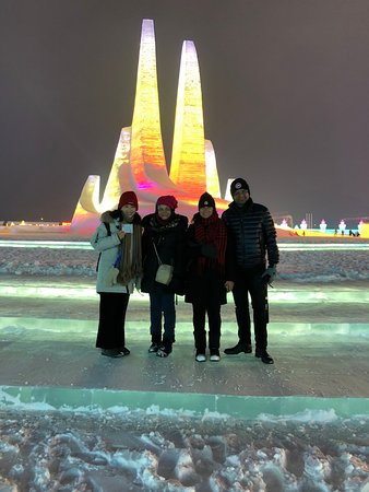 Harbin Private Tour Guide English-speaking Sera Hao with her guests at Harbin ice and snow world for ice festival 29 December 2019, all our tour guide must accompany the guests into park and explain something to their guests