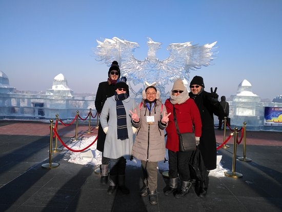 Harbin Private Tour Guide English-speaking Maggie Liu with her guests at songhua river side ice and snow Ice and snow entertainment 2 December 2020