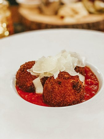 Short Rib Arancini -- Deep fried risotto ball stuffed with braised beef short rib and smoked mozzarella, served with a short rib ragu -- it is TO DIE FOR.