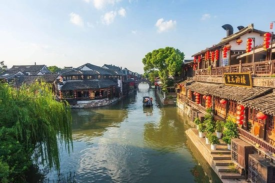 Xitang Water Town Layover Tour from...