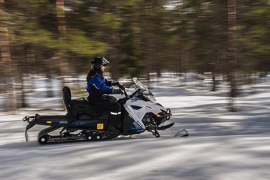 All Day Snowmobile Driving Photo