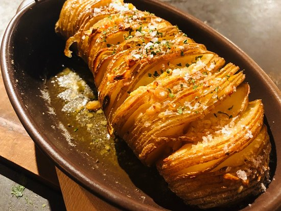 """Hasselback""potato with garlic butter"