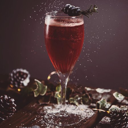 Aurora Sour - a drink with akvavit, pickled cranberries and prosecco.