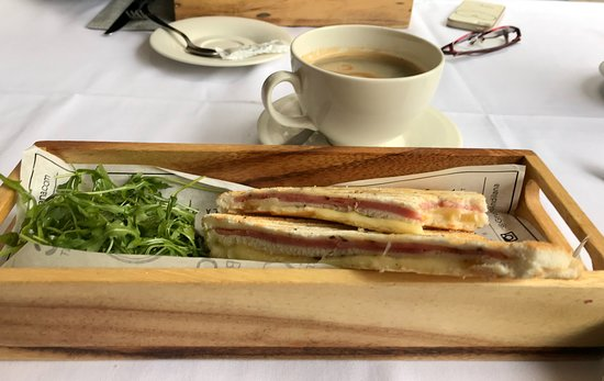 Toasted ham and cheese with a fresh coffee