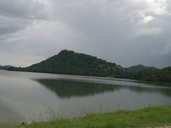 ‪‪Sorabora Lake‬: Sorabora Wewa (Sinhalese: සොරබොර වැව) is an ancient reservoir in Mahiyangana, Badulla District in Uva Province, Sri Lanka. It is thought to have been constructed during the reign of King Dutugemunu (161 BC – 137 BC) by a giant named Bulatha. In the ancient past, this tank was known as the 'Sea of Bintenna'. This rock cut deep canal acts as the sluice for the tank. Currently the tank and this ancient structure have been declared as archaeological protected monuments. The tank was built by damming‬