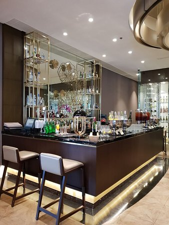 Get your drink at level 6, PASOLA Bar.