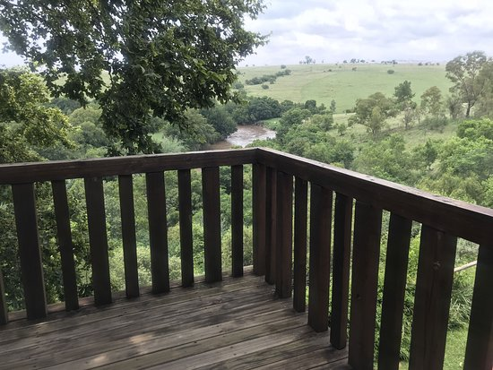 Starling deck overlooking view of river and hills