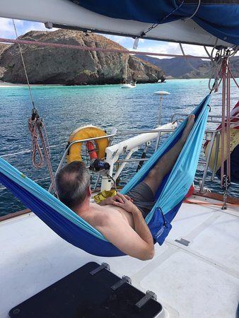 Relaxing via hammock after snorkeling