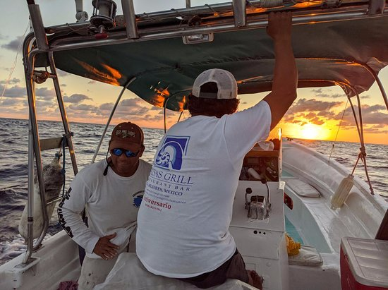 Mahache Tours: Captain Fausto and Manual enjoying the beautiful sunrise on the way to a perfect day of fishing.