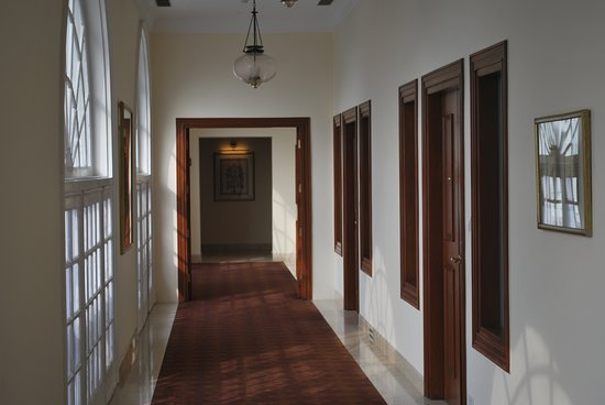 Hallway to room on third floor. Rooms on the right. Front of property to the left