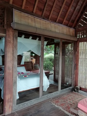 This is the view from outside looking to the bedroom inside of Villa Basuki