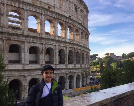 My younger son outside the Colosseum