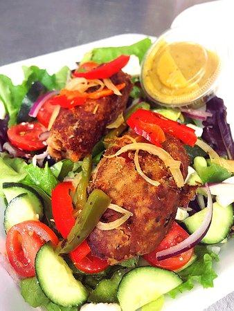 FISH/ VEGGIE/OR STEAK OVER A GREEK SALAD WITH A LEMON VINAIGRETTE