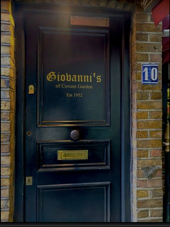 A happy sight: the doorway to Giovanni's off Goodwin's Court in Covent Garden, London.