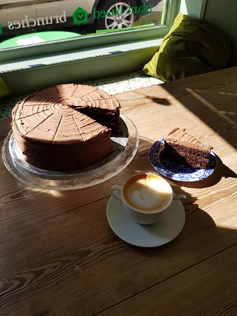 chocolate fudge cake with oat milk latte