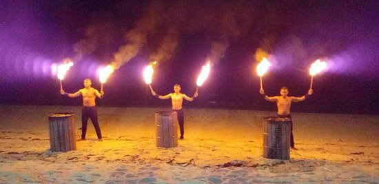 part of the entertainment for a function on the beach