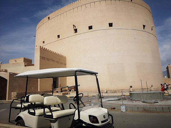 We are at Nizwa Fort; find the white golf cart to join a guided, exciting 20 minutes trip