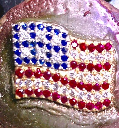 Custom made American flag pin in 18k rose gold.