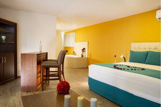 Habitación  categoría Deluxe  ideal para lunamieleros Deluxe category room ideal for honeymooners