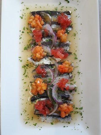 Ceviche de sardinas de vilanova y melocotón de Ordal