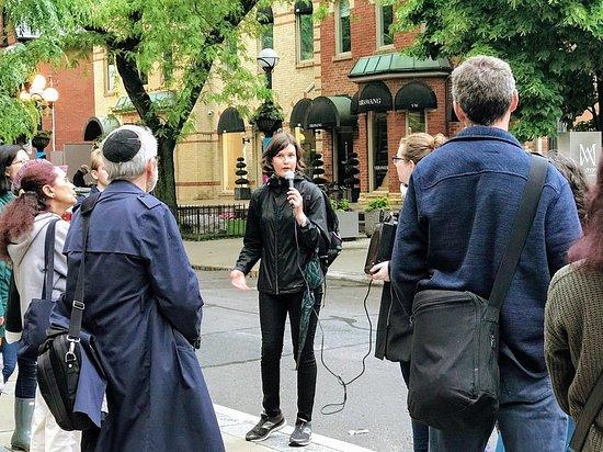 Volunteer presenting tour.