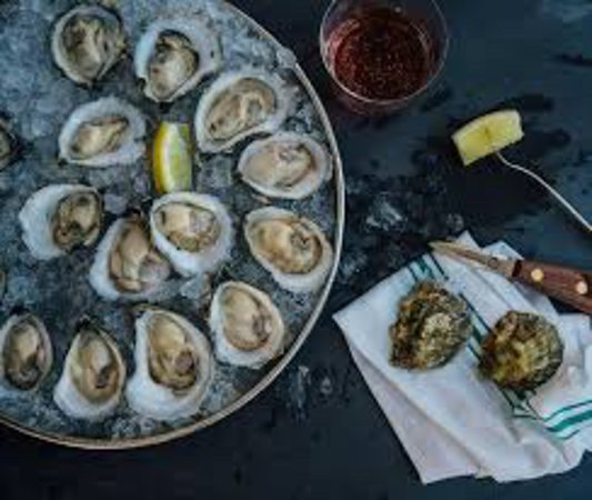 Buck a shuck oysters with the purchase of a bottle of wine all January